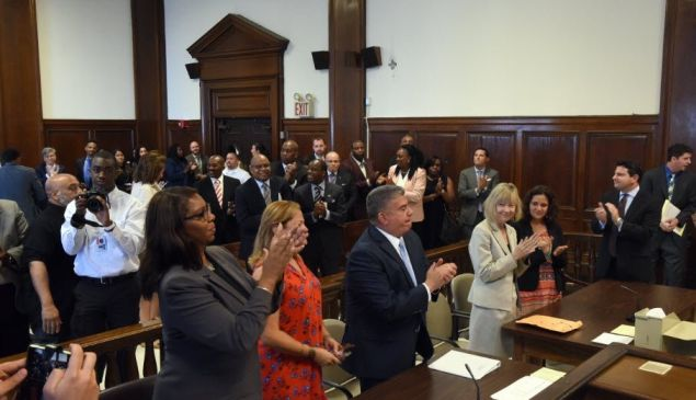 Acting Brooklyn District Attorney Eric Gonzalez, flanked by Public Advocate Letitia James and City Council Speaker Melissa Mark-Viverito, vacated more than 143,000 old summons warrants.