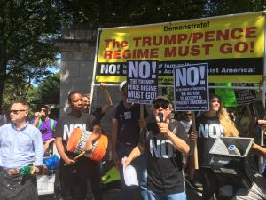 Members of activist group Refuse Fascism speaking at a Charlottesville solidarity rally in Columbus Circle.