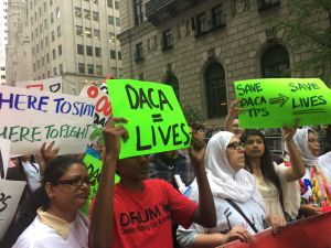 Immigrant advocates rallied by Trump Tower urging him to protect the Deferred Action for Childhood Arrivals and Temporary Protected Status programs for undocumented immigrants.