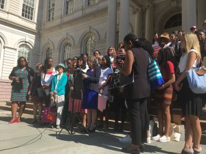 The City Council Women's Caucus held a rally about a report on the underrepresentation of women in the City Council.