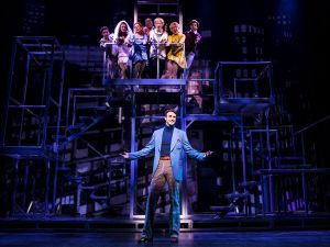 Michael Xavier (center) performs a number from Company with the Prince of Broadway cast.