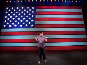Michael Moore takes center stage in The Terms of My Surrender at the Belasco Theatre.