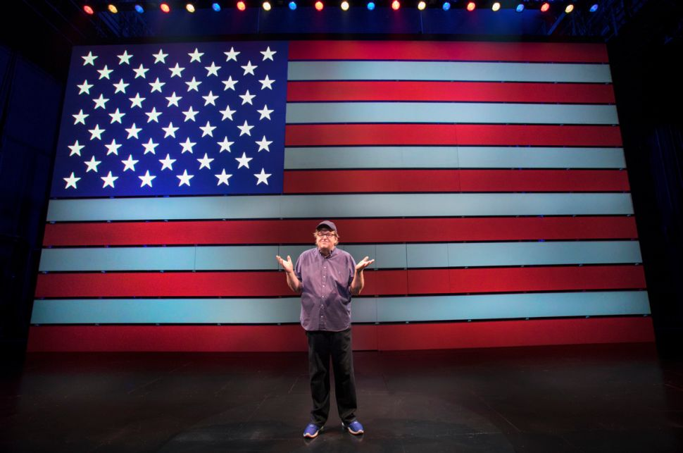 Michael Moore Adds Razzle-Dazzle to Political Provocation in One-Man Broadway Show