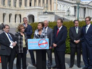 U.S. Rep. Nydia Velazquez, center, and U.S. Rep. José Serrano, far right, at a press conference.