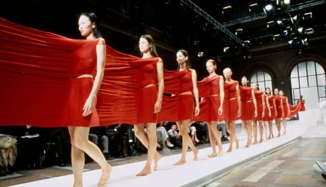 This long, red Issey Miyake dress is modern, for sure.