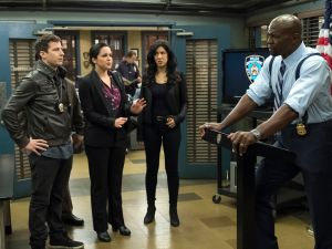 Andy Samberg, Amy Santiago, Stephanie Beatriz and Terry Crews in Brooklyn 99.
