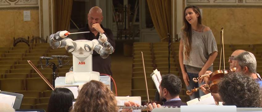 This Robot Conducting an Orchestra Mimics Human Movements but Lacks Human Soul