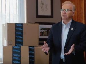 Mayor Mark Boughton of Danbury, CT surrounded by Amazon boxes. Looks natural, right?