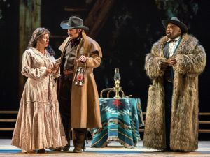 Minnie (Kristin Sampson) confronts the sheriff's posse in 'La Fanciulla del West'.