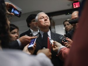Attorney General Jeff Sessions talks with reporters.