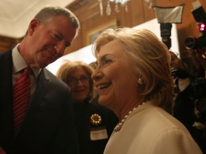 Hillary Clinton speaks with New York City Mayor Bill de Blasio on November 19, 2015 in New York City.