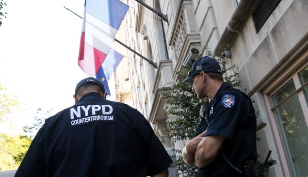 New York City Police Department counterterrorism officers stand guard outside the French Consulate, July 15, 2016 in New York City.