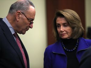 Senate Minority Leader Charles Schumer talks with House Minority Leader Nancy Pelosi during a news conference at the U.S. Capitol on March 14, 2017.