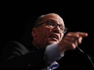 "MIAMI, FL - APRIL 19: DNC Chair Tom Perez speaks during a ""Come Together and Fight Back"" tour at the James L Knight Center on April 19, 2017 in Miami, Florida. Mr. Perez and Sen. Bernie Sanders (I-VT) spoke on topics from raising the minimum wage to $15 an hour, pay equity for women, rebuilding the crumbling infrastructure, combatting climate change, making public colleges and universities tuition-free, criminal justice reform, comprehensive immigration reform and tax reform which demands that the wealthy and large corporations start paying their fair share of taxes. (Photo by )"