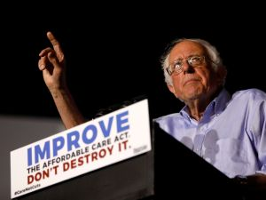 "Senator Bernie Sanders speaks at a ""Care Not Cuts"" rally on July 9, 2017 in Covington, Kentucky."