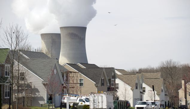 Cooling towers from the Limerick Generating Station, a nuclear power plant in Pottstown, Pennsylvania, are seen from a nearby neighborhood March 25, 2011. Limerick consists of two boiling water reactors designed by General Electric and is located on the Schuylkill River.