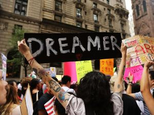 Immigration advocates attend a rally outside of Trump Tower in New York City.