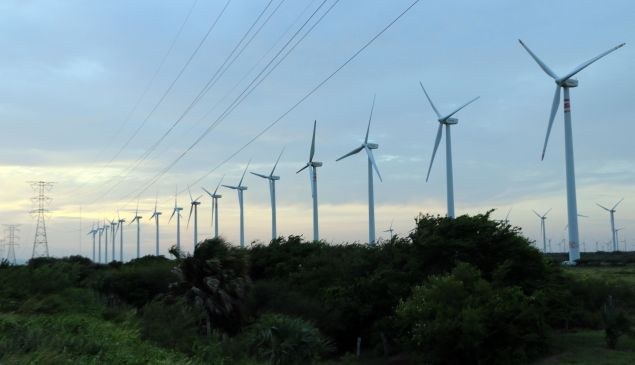 View of a windmill farm and power lines in La Ventosa, Mexico.