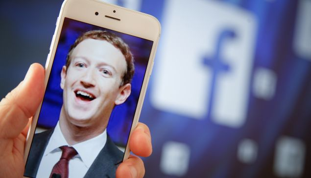 A portrait of Facebook found Mark Zuckerberg is seen on an iPhone in this photo illustration on 28 August, 2017.