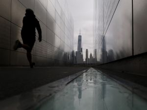 JERSEY CITY, NJ - SEPTEMBER 6: A man runs through the Empty Sky 9/11 Memorial in Liberty State Park in front of lower Manhattan and One World Trade Center in New York City on September 6, 2017 in Jersey City, New Jersey.