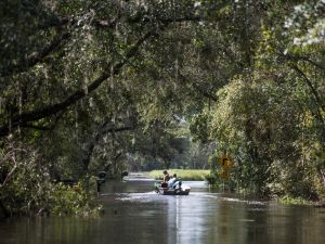 PALATKA, FL - SEPTEMBER 12: People use a boat and four wheeler to navigate flood waters caused by Hurricane Irma Sept. 12, 2017 near Palatka, Florida, United States. The storm brought flooding to areas not seen in generations.