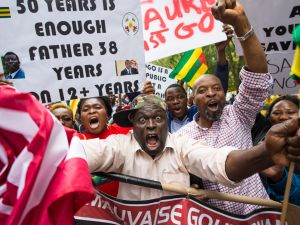 Abdou Razak of Togo demonstrates against Togolese President Faure Gnassingbé, who inherited the position from his father, but has since been re-elected twice. Protestors want him to step down immediately, and to revive a paragraph of the government's constitution stating that no politician should serve more than two terms.