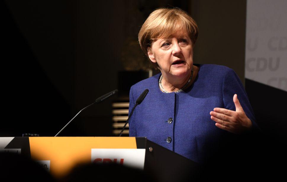 Set to Win Re-Election, Angela Merkel Weathers Storm of Western Turmoil