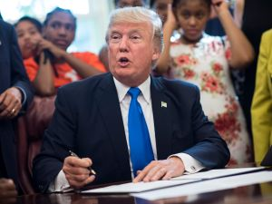 President Donald Trump speaks alongside students before signing a memorandum to expand access to STEM education in the Oval Office on September 25, 2017 in Washington, D.C.