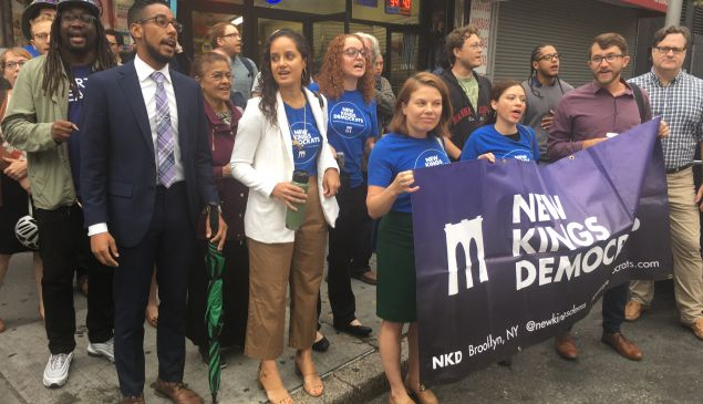 Members of New Kings Democrats, joined by Brooklyn Councilman Antonio Reynoso, protest against the Brooklyn Democratic Party.
