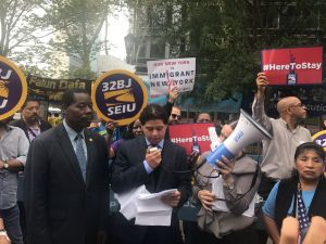 Advocates and elected officials rally near the United Nations to defend Temporary Protected Status.