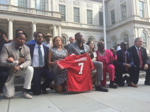 Council members kneeled in front of City Hall in a show of solidarity with NFL quarterback Colin Kaepernick and other NFL players protesting against police brutality and racial injustices.