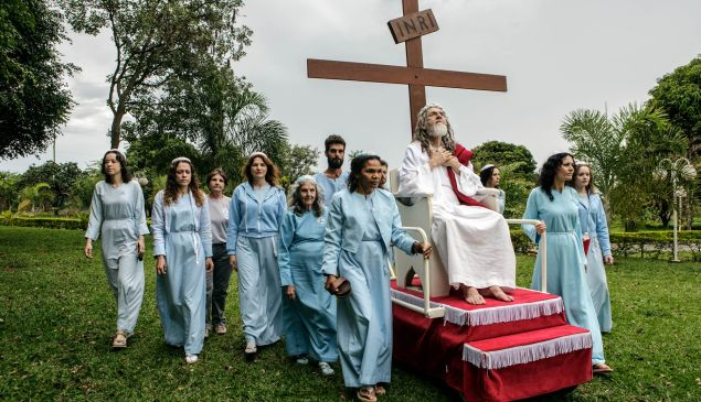 """INRI Cristo is wheeled around their compound on a rolling pedestal. """"INRI"""" are the initials that Pontius Pilate had written on top of Jesus's cross, meaning """"Jesus Christ, King of the Jews."""""""