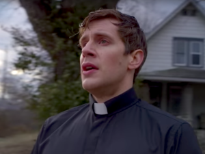 A still from The Good Catholic with Zachary Spicer as the young priest Daniel.