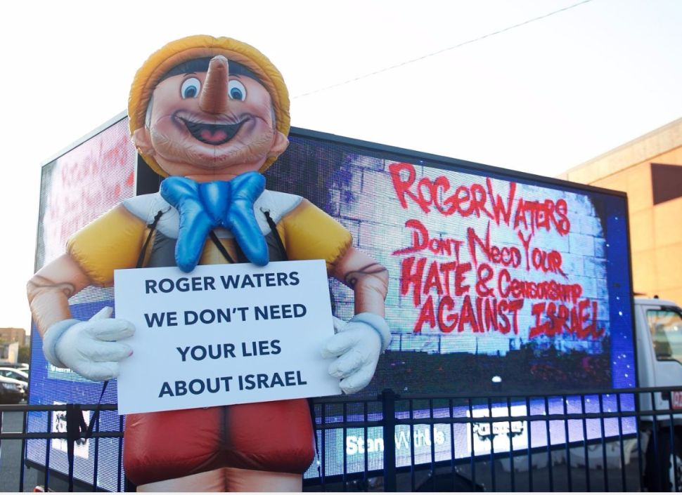 Roger Waters Greeted by Pinocchio and Pro-Israel Activists in Brooklyn