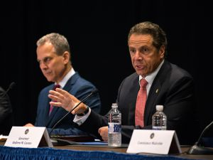 Gov. Andrew Cuomo, right, and New York Attorney General Eric Schneiderman, left, at a press conference.