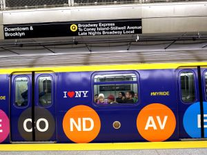 Commuters take the downtown Q train at the 72nd Street station on the newly opened Second Avenue subway line.