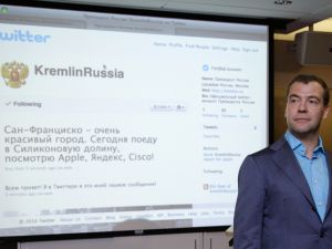 Former Russian President Dmitry Medvedev stands beside the Kremlin's Twitter page during his visit to the Twitter headquarters in Silicon Valley.