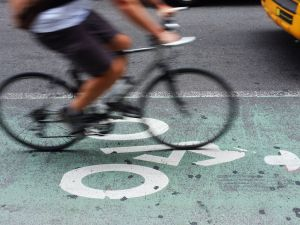 A cyclist speeding down a NYC bike lane.