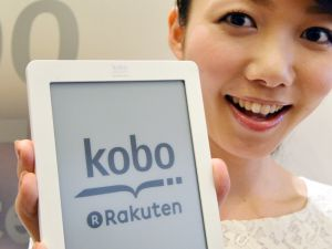 "A model displays top Japanese online retailer Rakuten new electronic book player ""Kobo Touch"" with a six-inch e-ink display in Tokyo on July 2, 2012 produced by Rakuten-owned Canadian popular ebook maker Kobo. Rakuten will launch an ebook service in the nation's largely untapped market on July 19, releasing the Kobo Touch reading device exactly at 100 USD."