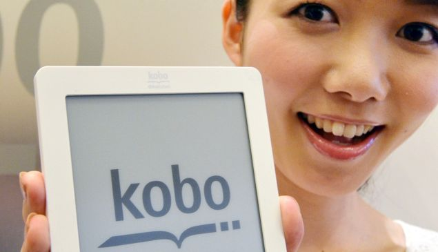 """A model displays top Japanese online retailer Rakuten new electronic book player """"Kobo Touch"""" with a six-inch e-ink display in Tokyo on July 2, 2012 produced by Rakuten-owned Canadian popular ebook maker Kobo. Rakuten will launch an ebook service in the nation's largely untapped market on July 19, releasing the Kobo Touch reading device exactly at 100 USD."""