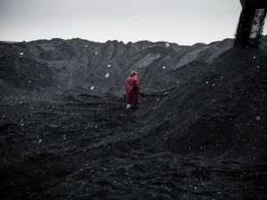 A quality control specialist collects samples of coal at Holodnaya Balka mine in Makeevka, Ukraine.