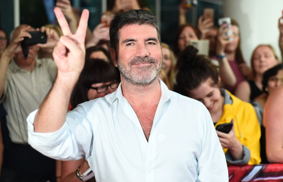 Simon Cowell Rushed to Hospital After Fall Down the Stairs