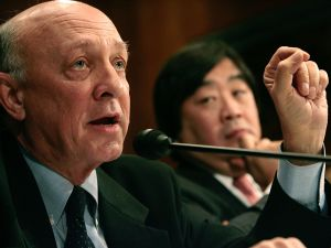 WASHINGTON - FEBRUARY 28: Former CIA Director James Woolsey, vice president of the Global Strategic Security Division of Booz Allen Hamilton; and Harold Hongju Koh (R), dean of the Yale Law School, testify before the Senate Judiciary Committee on Capitol Hill February 28, 2006 in Washington, DC. The committee called the hearing on wartime executive power and the National Security Agency's surveillance authority.