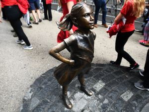 Fearless Girl stands on Wall Street.