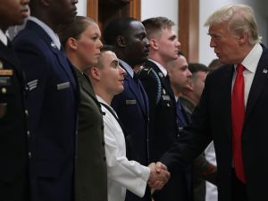 President Donald Trump shakes hands at the Pentagon.