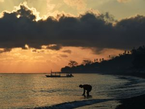 Sunrise at Amed beach in Karangasem on the island of Bali.
