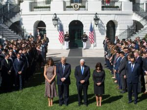 US President Donald Trump First Lady Melania Trump, US Vice President Mike Pence and his wife, Karen, participate in a moment of silence on the South Lawn of the White House in Washington, DC, October 2, 2017, for the victims of the shooting yesterday in Las Vegas, Nevada. / AFP PHOTO / SAUL LOEB (Photo credit should read SAUL LOEB/AFP/Getty Images)