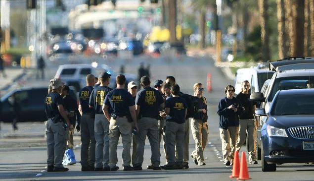 FBI investigators gather outside the Route 91 festival venue on October 3, 2017 after a gunman killed more than 59 people and wounded more than 527 others when he opened fire on a country music festival in Las Vegas, Nevada on October 1, 2017.