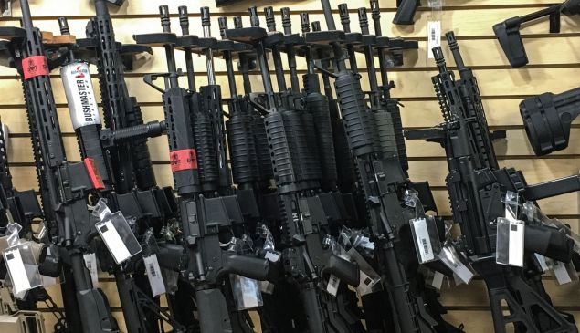 Semi-automatic rifles are seen for sale in a gun shop in Las Vegas, Nevada on Oct. 4, 2017.