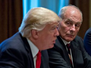 White House chief of staff John Kelly listens as U.S. President Donald Trump speaks at a briefing with senior military leaders.